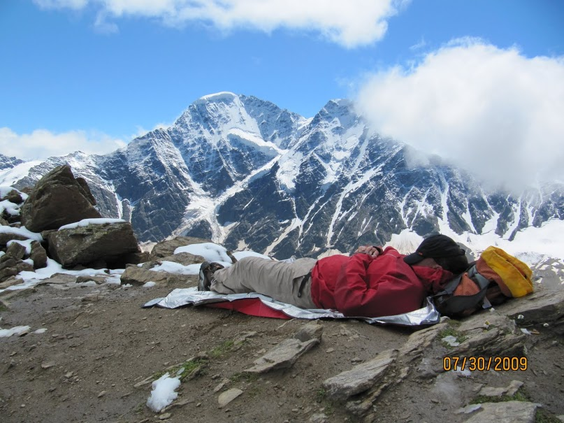 Team member Richard Birkill napping with Caucuses Range in background.