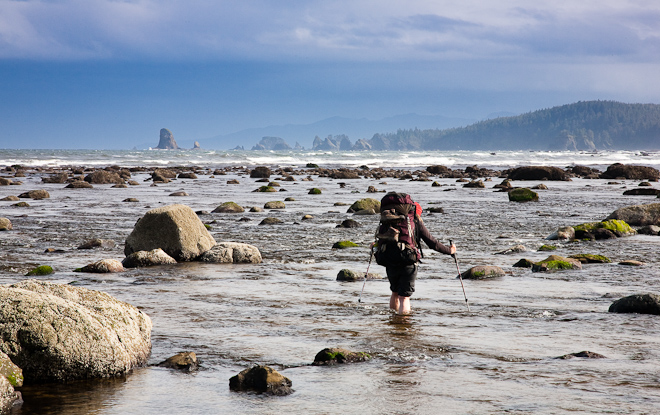 Fording the Ozette River at low tide. Trekking poles come in handy. Photo by John D'Onofrio