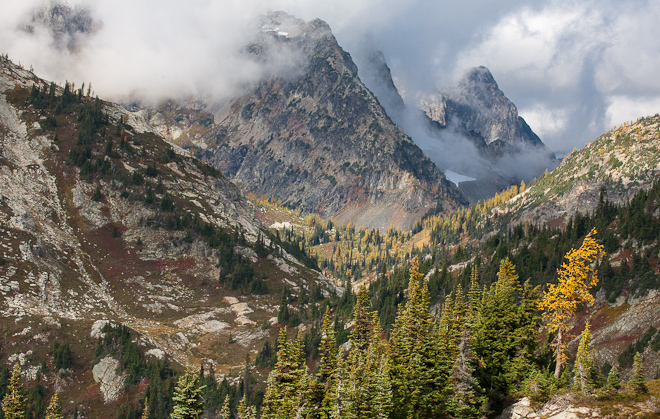 Black Peak rises into the clouds above Maple Pass