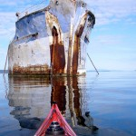 One of a dozen rusting World War II ships chained in shallow water north of Powell River, BC