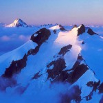 Icy Peak at sunrise from the summit of Ruth Mountain, North Cascades National Park, Washington, USA.