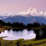 Glacier Peak and pink skies above Image Lake at dawn, Glacier Peak Wilderness, North Cascades, Washington.