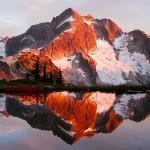 Evening light on Whatcom Peak reflected in a tarn above Whatcom Pass, North Cascades National Park, Washington, USA.