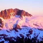 Morning alpenglow on Mt. Challenger from high camp near Luna Pass, Picket Range, North Cascades National Park, Washington, USA.