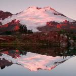 Evening light on Mount Baker reflected in a tarn below Park Butte, Mount Baker Wilderness, North Cascades, Washington.