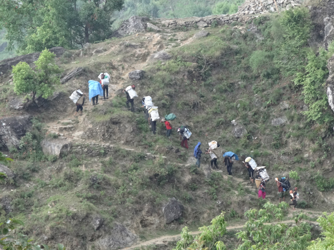 Villagers carrying relief supplies, Samir Jung Thapa, Clikman Photography